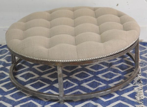 Circular Grey Ottoman upholstered with metal base finish