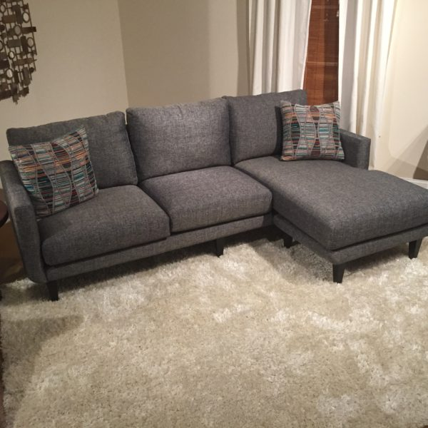 Grey Upholstered Sectional Sofa with Black Legs