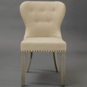 Tan Upholstered Dining Chair with Tufting and Nailhead Trim