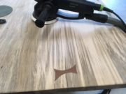 Sanding tool Bow Tie fastener on live edge table