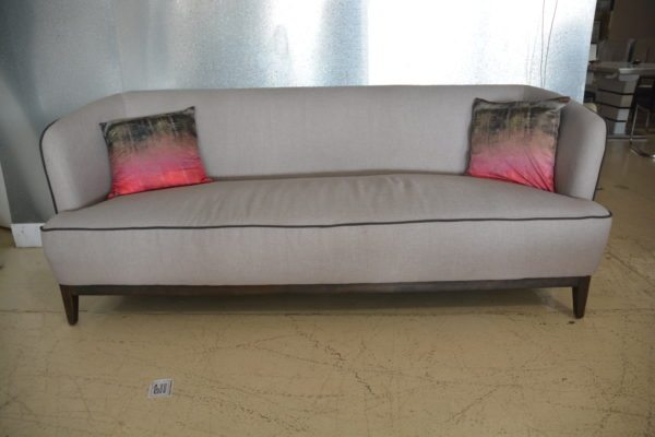 Cabria soft grey sofa with brown wood base