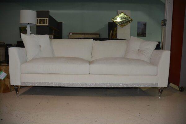 White sofa with elagant silver trim