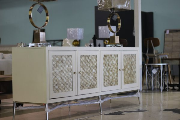 Cream Wood Sideboard stands on chrome metal frame