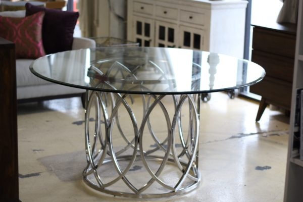 Glass top cocktail table on an elagant chrome metal stand