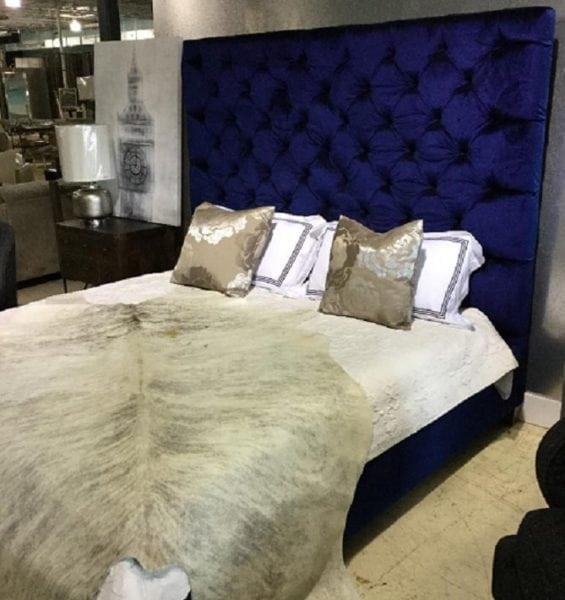 blue tufted bed